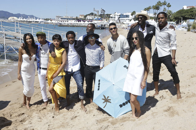 From left, Chanel Iman, Pharell Williams, Kiersey Clemons, Shameik Moore, Amin Joseph, Tony Revolori, Quincy Brown, Zoe Kravitz, Rick Famuyiwa and A$AP Rocky pose for photographers during a photo call for the film Dope, at the 68th international film festival, Cannes, southern France, Friday, May 22, 2015. (Photo by Joel Ryan/Invision/AP Photo)