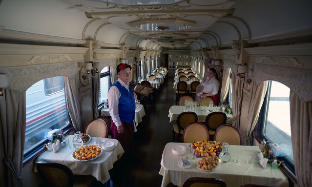 A view of a dining car of the first tourist train passing through Russia's Arctic regions to Norway as it prepares to leave Saint Petersburg for a 11-day trip with 91 passengers on board, June 5, 2019. (Photo by Olga Maltseva/AFP Photo)