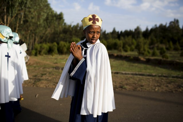 A Christian Orthodox girl sings with her choir on a road on the outskirts of Addis Ababa, Ethiopia, May 16, 2015. (Photo by Siegfried Modola/Reuters)