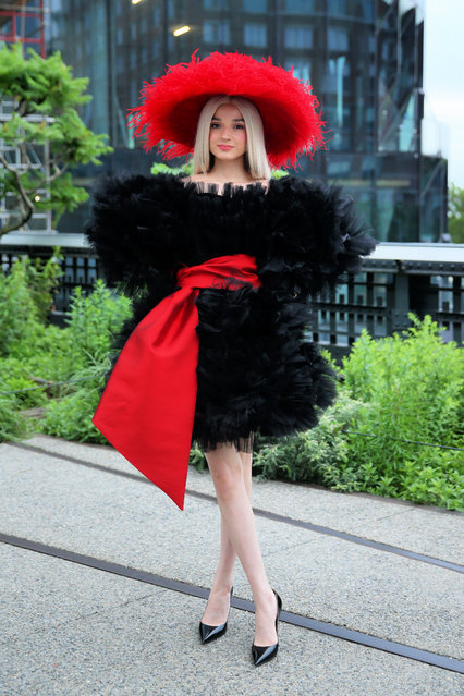 Singer Moriah Rose Pereira, known professionally as Poppy, wearing a red feather hand and black feather dress, attends the 'Clothing Optional: Hats Required' fundraiser for The Highline in New York City on June 13, 2019. (Photo by Christopher Peterson/Splash News and Pictures)