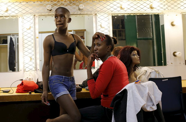 Contestants look on as they prepare themselves backstage ahead of the Miss Gay Jozi pageant in Johannesburg, May 23, 2015. (Photo by Siphiwe Sibeko/Reuters)