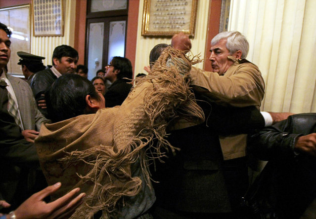 Bolivian opposition congressman Fernando Rodriguez battles with an unidentified indigenous deputy of President Evo Morales' party during a congress session  in La Paz, April 9, 2009. (Photo by David Mercado/Reuters)