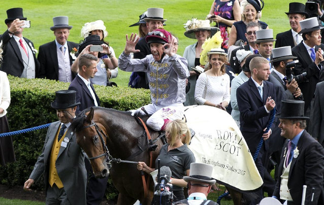 Jockey Frankie Dettorio celebrates after his 50th Royal Ascot win on Osalia in the Sandringham Handicap Stakes on the second day of the Royal Ascot horse racing meet at Ascot, England, Wednesday, June 17, 2015. Royal Ascot is the annual five day horse race meeting that Britain's Queen Elizabeth II attends every day of the event. (AP Photo/Alastair Grant)