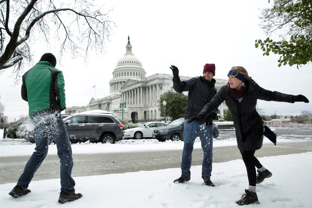Tourists Jake Lambert, Clay Lambert and Kelsey Chaloux from Orlando, Florida play with snowballs on Capitol Hill in Washington, U.S., March 14, 2017. (Photo by Yuri Gripas/Reuters)