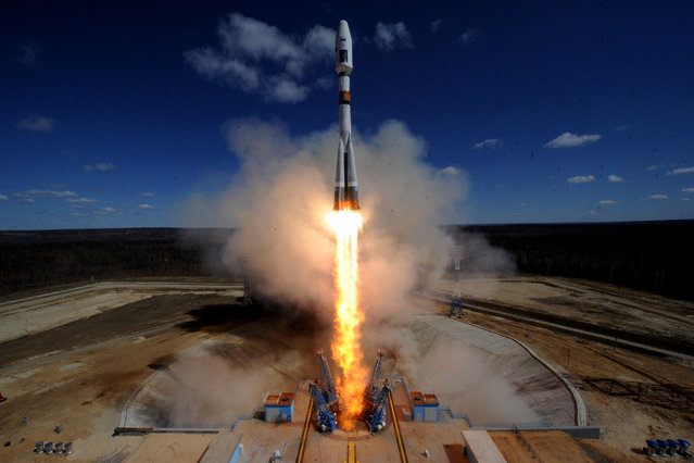 A Russian Soyuz 2.1a rocket carrying Lomonosov, Aist-2D and SamSat-218 satellites lifts off from the launch pad at the new Vostochny Cosmodrome outside the city of Uglegorsk, about 200 kilometers (125 miles) from the city of Blagoveshchensk in the far eastern Amur region Thursday, April 28, 2016. (Photo by Kirill Kudryavtsev/Pool Photo via AP Photo)
