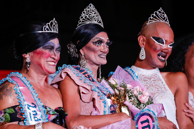 """Joel Pedrigal (C) alias """"Angel Locsin"""" poses for pictures with Rolando Picazo (L) alias """"Chamcey Supot"""" and Ariel Bacierra (R) alias """"Bea Bunda"""" after winning the Miss Gay Chararat 2019, a gay beauty contest in Makati, south of Manila, Philippines, early 11 June 2019. Bacierra and Picazo came in second and third, respectively. The pageant is a project of the Committee on Cultural Affairs and Barangay Council in San Antonio, Makati as part of their one week festival honoring Saint Anthony of Padua and in celebration of the LGBT (lesbian, gay, bisexual and transgender) Pride month. Gay beauty pageants have been organized in the Philippines since the late 1970s. Contestants come from different backgrounds and professions with ages ranging from fourteen to more than sixty years old. In recent years, the country saw how gay pageants evolved from being part of local festivities to mainstream social spectacles at the national and even international level. Contestants regard pageants as opportunities to express their creativity, to create awareness against discrimination and to advocate for the recognition of their legal rights. Despite the strides made to break gender stereotypes, the LGBT community in the Philippines still feels that much has to be done to achieve acceptance and equality in a conservative and religiously-biased society. LGBT groups have continuously called for equal rights including legalization of same-s*x marriage and the passage of the Anti-Discrimination Bill. At the end of June, thousands of members and supporters of the LGBT community are expected to join the LGBT Pride March. (Photo by Mark R. Cristino/EPA/EFE)"""