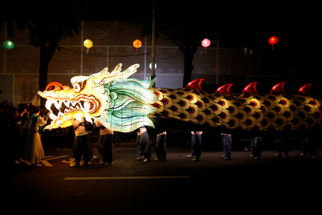 Buddhists carry a dragon-shaped lantern during a lotus lantern parade in celebration of the upcoming birthday of Buddha in Seoul, South Korea, May 7, 2016. (Photo by Kim Hong-Ji/Reuters)
