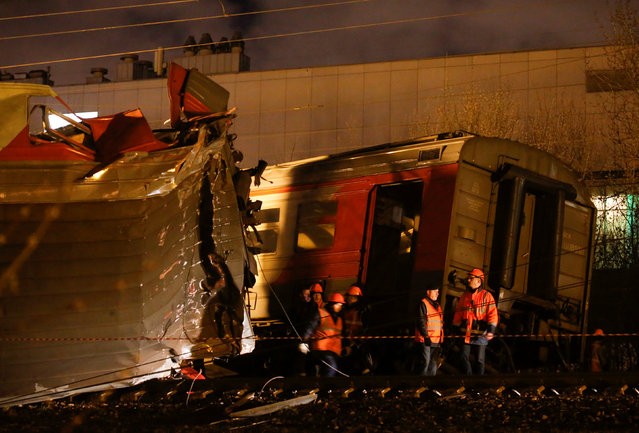 Emergencies Ministry members work at the site of a collision between a passenger train and a suburban train in Moscow, Russia April 9, 2017. (Photo by Maxim Shemetov/Reuters)