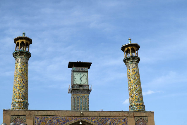 The minarets and clock tower of the Imam Khomeini mosque are pictured near Tehran's Grand Bazaar, Iran May 2, 2016. (Photo by Marius Bosch/Reuters)