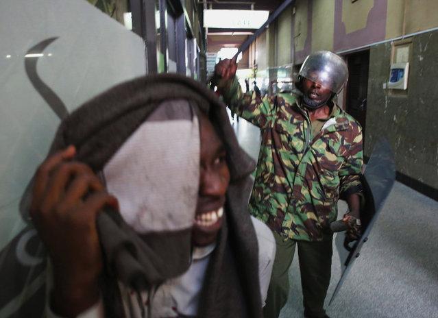 A Kenyan policeman beats a protester during clashes in Nairobi, Kenya May 16, 2016. (Photo by Goran Tomasevic/Reuters)