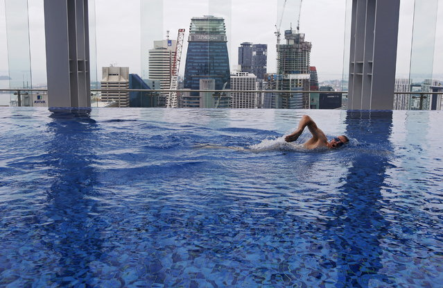 Fitness coach Peter Yeoman swims in the pool of Gravity health and fitness club in Singapore's central business district (CBD) July 15, 2015. The S$9.5 million($7 million) luxury gym opened by British-based fitness chain Fitness First, which sits on top of an office building in the CBD, is targeted at C-Suite executives and membership is offered by invitation only to 999 people, according to the club's press release. (Photo by Edgar Su/Reuters)