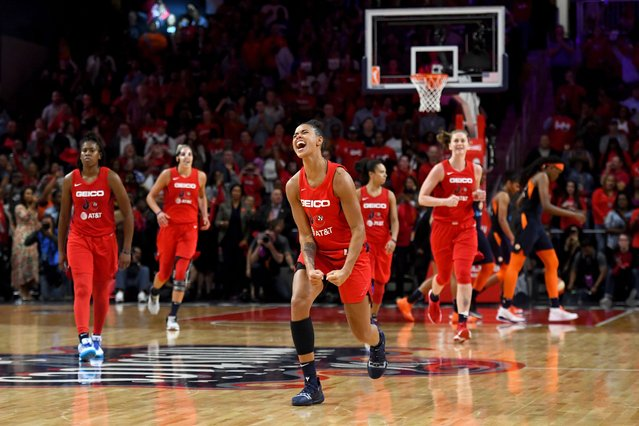 Mystics guard Natasha Cloud, center, celebrates with seconds to go in the game as her team wins the WNBA championship over the Connecticut Sun in Washington, D.C. on October 10, 2019. (Photo by Katherine Frey/The Washington Post)