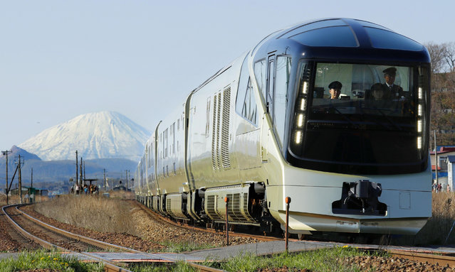 "East Japan Railway Co.'s new luxury sleeper train, ""Train Suite Shiki-shima"", runs on May 2, 2017, in Date, Hokkaido, with Mt. Yotei in the background. The train began its first trip in Tokyo the previous day and is scheduled to return on May 4. (Photo by Kyodo News via Getty Images)"