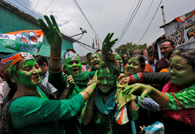 Supporters of Trinamool Congress (TMC) celebrate after learning the initial poll results of the West Bengal Assembly elections, in Kolkata, India May 19, 2016. (Photo by Rupak De Chowdhuri/Reuters)