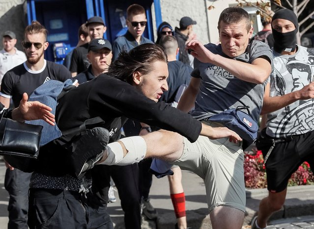 Anti-LGBT protesters attack a participant in the KharkivPride march in support of the LGBT community in Kharkiv, Ukraine September 15, 2019. (Photo by Gleb Garanich/Reuters)