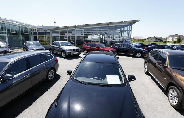 Cars are seen at a car dealership in Fischerdorf, near Deggendorf, May 19, 2014. REUTERS/Michaela Rehle
