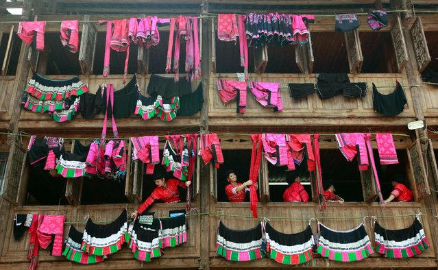 Yao people dry clothes under sunshine during Clothes Drying Festival on Longji Rice Terrace on July 21, 2015 in Guilin, China. In Red Yao tradition, it's said that the sunlight on June 6 of Chinese lunar calendar has the strongest power to disinfect clothes. Clothes drying under the blazing sun won't get moldy and avoid from insects. (Photo by ChinaFotoPress via Getty Images)