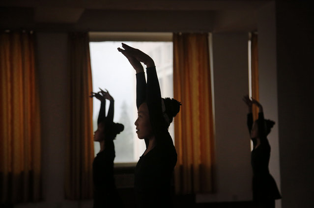 School girls are silhouetted during a dance class, Thursday, May 7, 2015, in Pyongyang, North Korea. (Photo by Wong Maye-E/AP Photo)