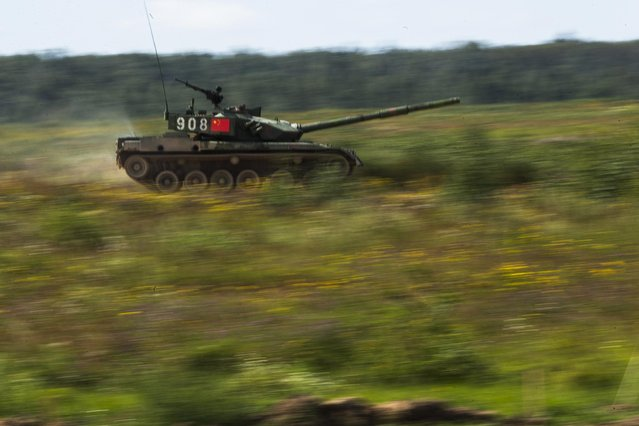 A Chinese tank moves at speed during competition in Alabino, outside Moscow, Russia, Monday, August 3, 2015. (Photo by Pavel Golovkin/AP Photo)