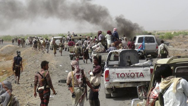 Fighters loyal to Yemen's President Abd-Rabbu Mansour Hadi gather on a road leading to the  al-Anad military and air base in the country's southern province of Lahej August 3, 2015. Fighters loyal to Yemen's exiled president Abd-Rabbu Mansour Hadi, bolstered by Gulf Arab support, seized the country's largest military base from Houthi forces on Monday after heavy combat in which dozens were killed or captured, a pro-Hadi commander said. (Photo by Reuters/Stringer)