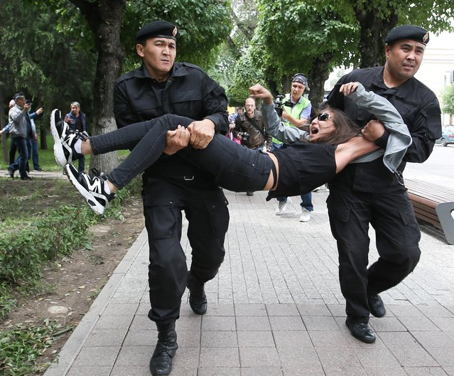 Police officers detain an opposition supporter during a protest against presidential election results, in Almaty, Kazakhstan, June 10, 2019. (Photo by Pavel Mikheyev/Reuters)