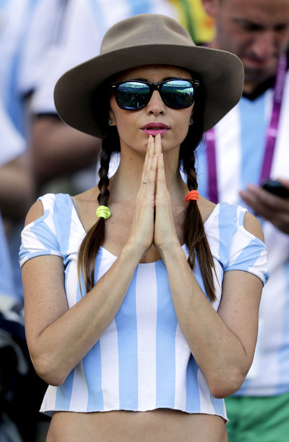 An Argentina gestures before the World Cup final soccer match between Germany and Argentina at the Maracana Stadium in Rio de Janeiro, Brazil, Sunday, July 13, 2014. (Photo by Matthias Schrader/AP Photo)