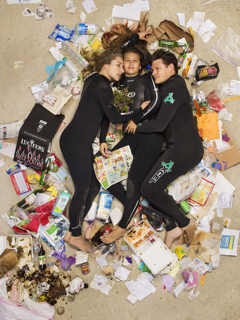 Susan, Curtis and Brittany surrounded by seven days of their own rubbish in Pasadena, California. If you've never thought about how much rubbish you throw away an honest photographic series will open your eyes. Men, women, couples and families with young children have been photographed lying on their backs surrounded by a week's worth of their own rubbish – from old cartons of milk(Photo by Gregg Segal/Barcroft Media)