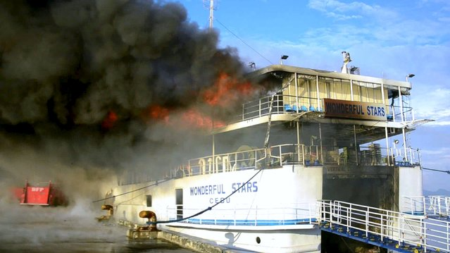 A large fire engulfs the MV Wonderful Stars passenger ship docked at the port in Ormoc city, central Philippines August 15, 2015. The MV Wonderful Stars of Roble shipping lines, carrying 544 passengers, was evacuated safely while three crew members were reportedly injured during the accident, local media reported. (Photo by Ronald Frank Odan Dejon/Reuters)