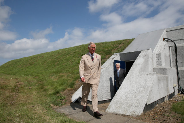 Prince Charles, Prince of Wales emerges from a fortified bunker during a tour of GCHQ Scarborough on July 30, 2014 in Scarborough, England. The Prince of Wales is patron of the Intelligence Services and visited Government Communications Headquarters (GCHQ) Scarborough to commemorate the centenary of the oldest existing intercept station in the world. The Prince met staff and also viewed the stations museum. (Photo by Christopher Furlong/Getty Images)