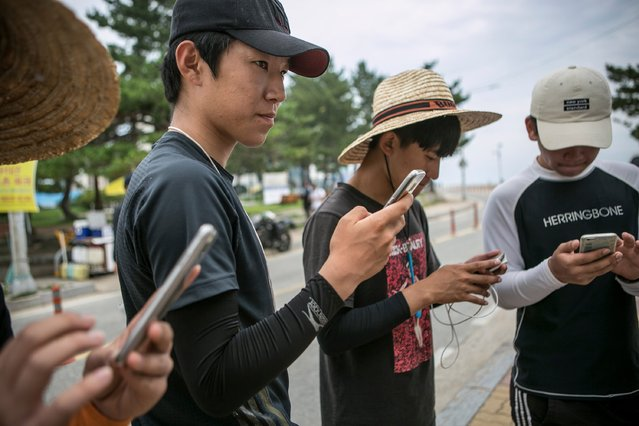 South Korean youths play Pokemon Go on July 15, 2016 in Sokcho, South Korea. (Photo by Jean Chung/Getty Images)