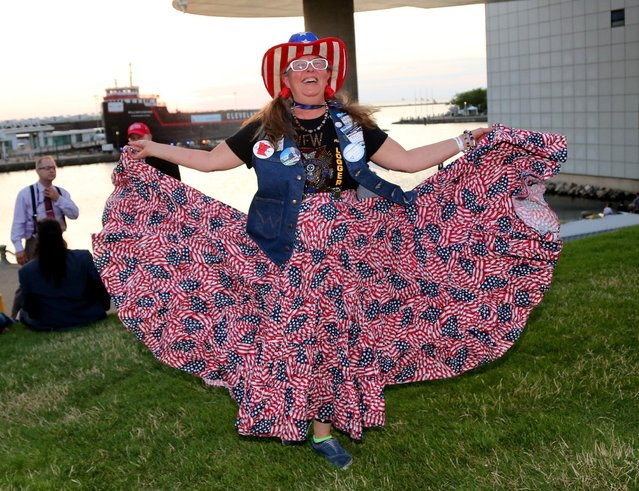 Republican U.S. presidential candidate Donald Trump supporter Susan Reneau shows off her dress during a Rock the Night kick off party on the sidelines of the Republican National Convention in Cleveland, Ohio, U.S., July 17, 2016. (Photo by Aaron Josefczyk/Reuters)