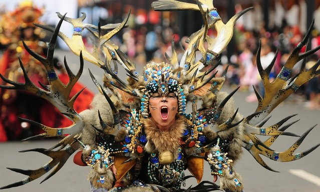A model wears a Wild Deers costume in the kids carnival during The 13th Jember Fashion Carnival 2014 on August 21, 2014 in Jember, Indonesia. (Photo by Robertus Pudyanto/Getty Images)