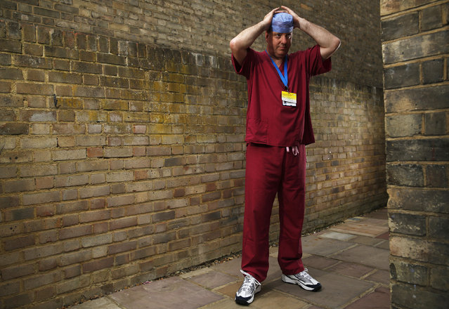 Theatre nurse Ciaran Dukes poses for a photograph in his scrubs in Bromley, southeast London, June 23, 2014. (Photo by Luke MacGregor/Reuters)
