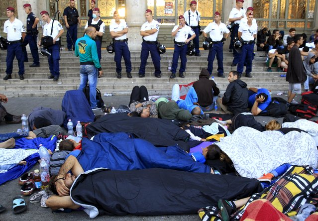 Migrants rest outside the main Eastern Railway station in Budapest, Hungary, September 2, 2015. (Photo by Bernadett Szabo/Reuters)