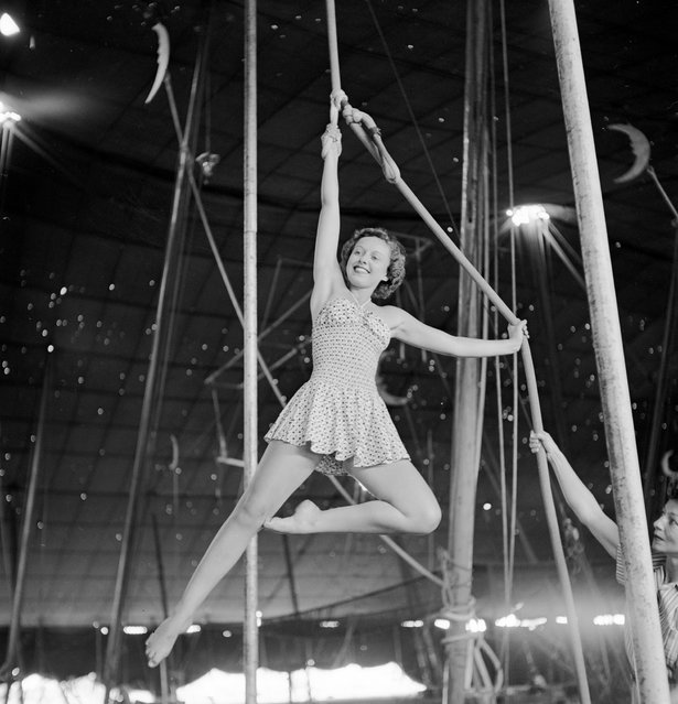 An aerialist rehearsing for the Ringling Bros. and Barnum & Bailey Circus while a circus girl is holding a rope in Sarasota, FL in 1949. (Photo By Nina Leen/Time Life Pictures/Getty Images)
