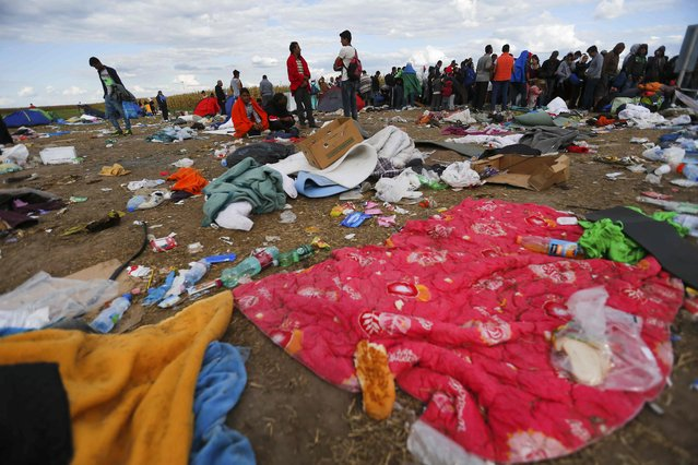 Blankets and garbage are pictured at a makeshift camp of migrants as they wait for buses at a collection point in the village of Roszke, Hungary, September 7, 2015. (Photo by Laszlo Balogh/Reuters)