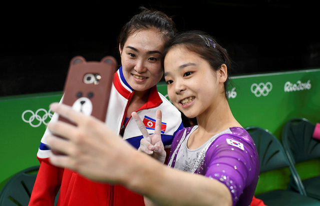 2016 Rio Olympics, Gymnastics training, Rio Olympic Arena, Rio de Janeiro, Brazil on August 4, 2016. Lee Eun-Ju (KOR) of South Korea (R) takes a selfie picture with Hong Un Jong (PRK) of North Korea. (Photo by Dylan Martinez/Reuters)