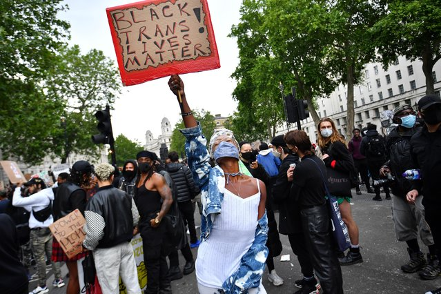 A demonstrator holds up a sign in Parliament Square during a Black Lives Matter protest in London, following the death of George Floyd who died in police custody in Minneapolis, London, Britain, June 7, 2020. (Photo by Dylan Martinez/Reuters)