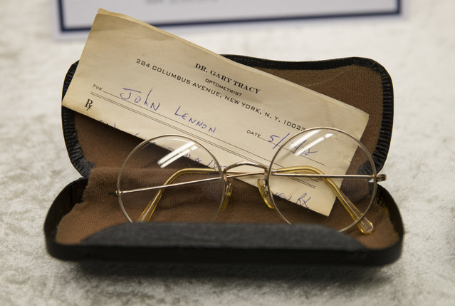 A pair of John Lennon's glasses with a prescription by optometrist Gary Tracy are displayed at the police headquarters in Berlin, Tuesday, November 21, 2017, after German police arrested a man suspected of handling stolen objects from Lennon's estate, including diaries which were stolen from Lennon's widow, Yoko Ono, in New York in 2006. (Photo by Markus Schreiber/AP Photo)