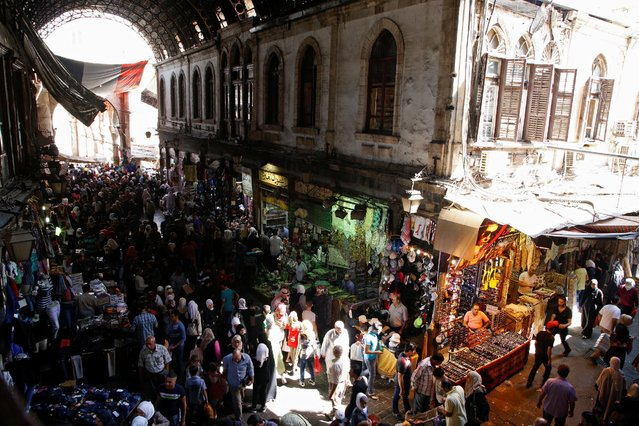 People shop ahead of eid celebrations in al-Hamidiyah Souq in Damascus, Syria September 10, 2016. (Photo by Omar Sanadiki/Reuters)