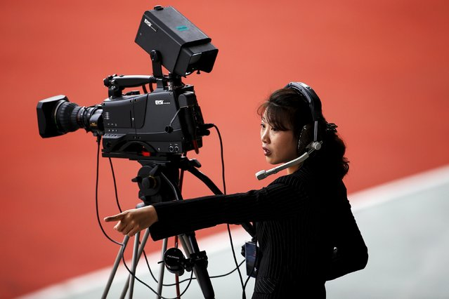 A camerawoman works during the preliminary 2018 World Cup and 2019 AFC Asian Cup qualifying soccer match between North Korea and Philippines at the Kim Il Sung Stadium in Pyongyang October 8, 2015. (Photo by Damir Sagolj/Reuters)