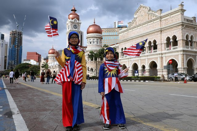 Girls wearing costumes made of Malaysian flags pose for a picture at Independence Square during Malaysia Independence Day, in Kuala Lumpur, Malaysia, August 31, 2020. (Photo by LIm Huey Teng/Reuters)