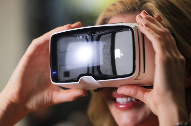 A model wears virtual reality glasses VR ONE Plus from Zeiss at the photokina trade fair in Cologne, Germany, 20 September 2016. The world's largest trade fair on photography, photokina, features some 1,000 exhibitors from 40 countries and will take place from 20 until 25 September 2016 in Cologne. The trade fair also features various photo exhibitions. (Photo by Oliver Berg/EPA)