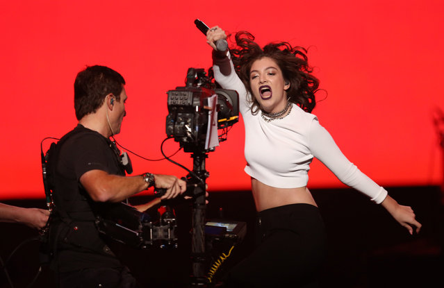 Lorde performs at the 42nd annual American Music Awards at Nokia Theatre L.A. Live on Sunday, November 23, 2014, in Los Angeles. (Photo by Matt Sayles/Invision/AP Photo)