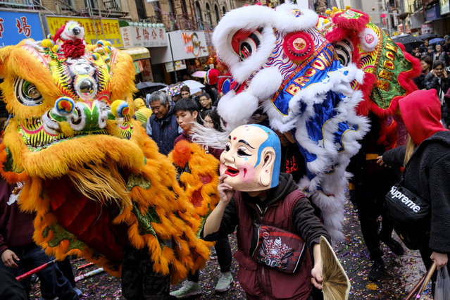 A dragon dance is performed during a cultural festival to mark the first day of the Lunar New Year in Chinatown neighborhood in Manhattan, February 16, 2018 in New York City. The 2018 Chinese New Year, which is the year of the dog, begins on Friday and celebrations will last for over two weeks. (Photo by Drew Angerer/Getty Images)