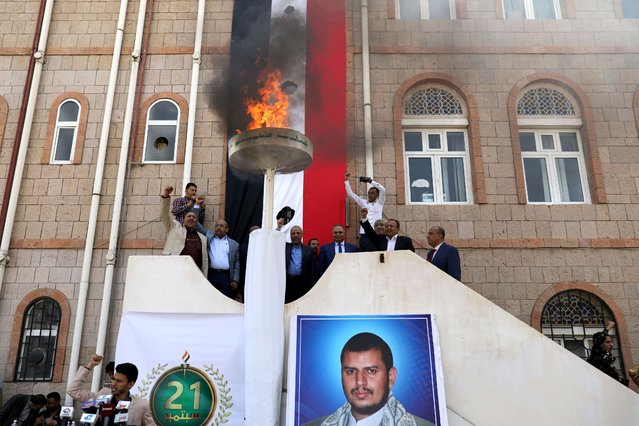Houthi education officials shout slogans after lighting a flame during a ceremony to mark the 6th anniversary of the takeover of Yemen's capital Sanaa by the Houthi movement, in Sanaa, Yemen on September 20, 2020. (Photo by Khaled Abdullah/Reuters)