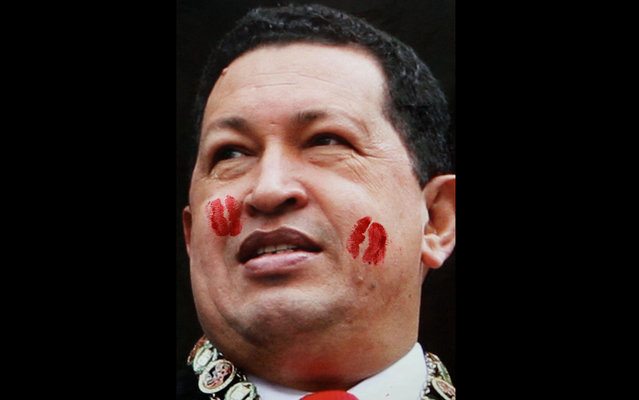 Poster with the image of Hugo Chavez with lipstick marks from his fans is seen on a wall near a book store in Caracas, Venezuela, on March 19, 2013. (Photo by Fernando Llano/AP Photo)