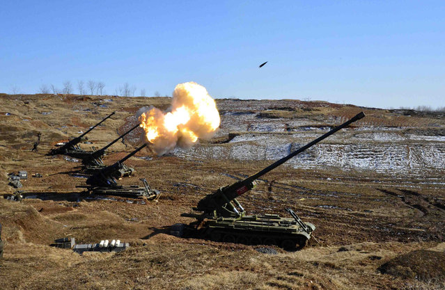North Korea's artillery sub-units, whose mission is to strike Daeyeonpyeong island and Baengnyeong island of South Korea, conduct a live shell firing drill in this picture released on March 14, 2013. (Photo by Reuters/KCNA)