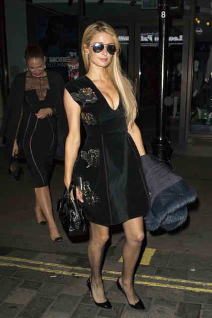 Paris Hilton checks out her cleavage then smiles before heading into the Teddy Bear Party in London on October 7, 2016. She was with a group of friends in the Chiltern Firehouse before hitting the Teddy Bear Party at 2.30am. (Photo by Splash News and Pictures)