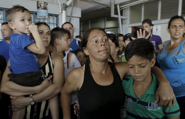 Cubans migrants listen as an immigration official speaks at the border post with Panama in Paso Canoas, Costa Rica November 14, 2015. The government of Costa Rica agreed to grant humanitarian visas to some 1,500 Cubans who are detained at the border with Panama, at Paso Canoas, on their way to the United States through Costa Rica, local media reported. (Photo by Juan Carlos Ulate/Reuters)